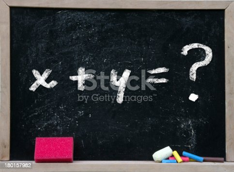 istock Math problem equation on a chalkboard with pink eraser 180157982