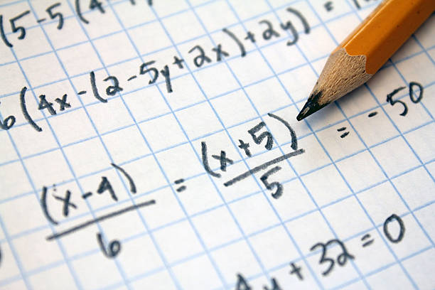 math problems math problems on graph paper with pencil mathematical symbol stock pictures, royalty-free photos & images