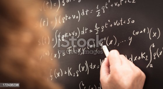 istock math teacher writing on the blackboard 172435238