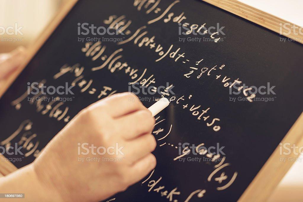 math teacher writing on the blackboard royalty-free stock photo