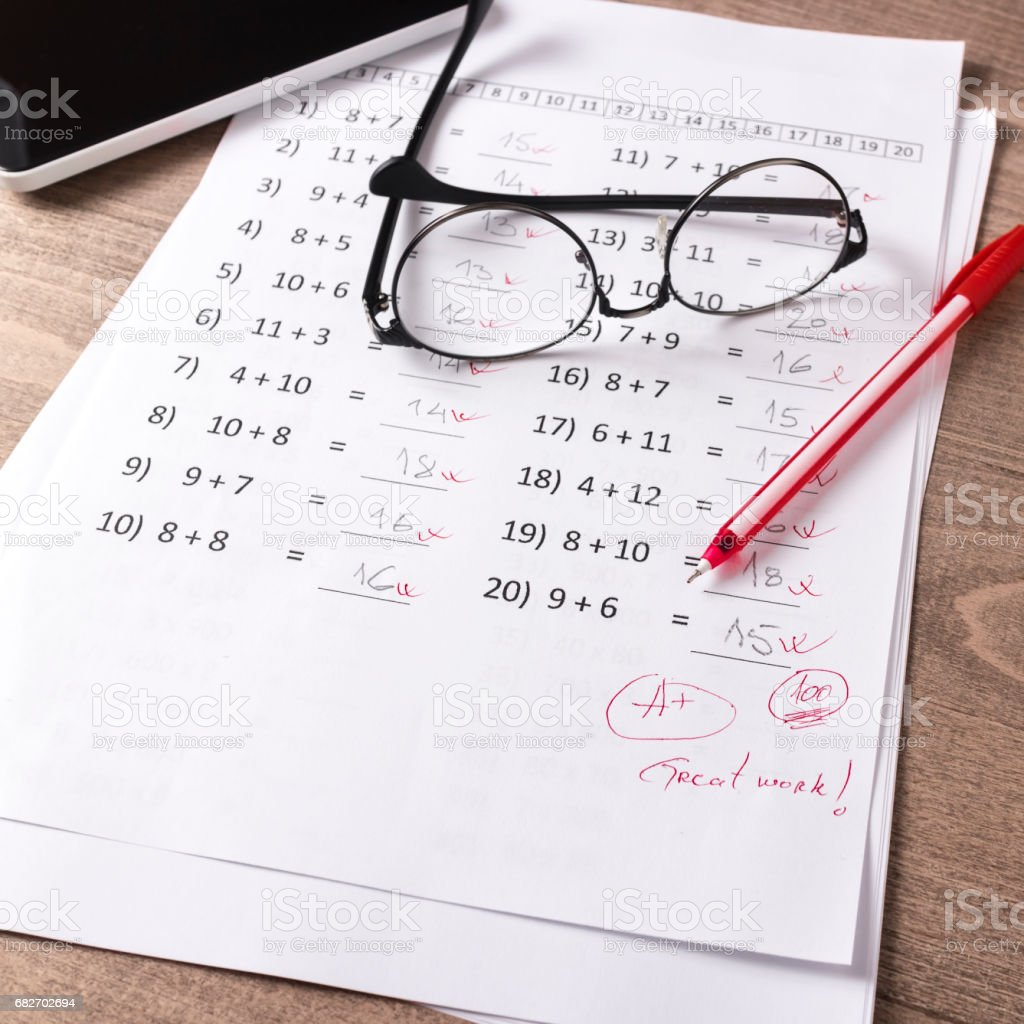 Math Test On Teacher Desk stock photo