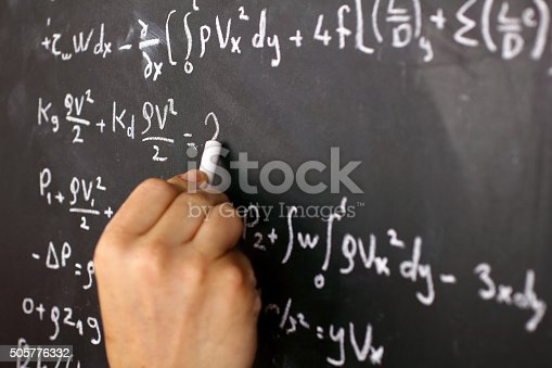 istock Mathematical equation on a chalkboard 505776332