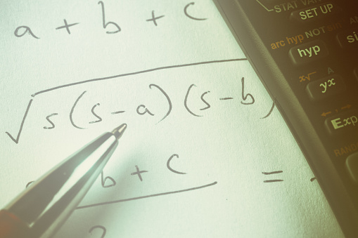 istock Mathematical equation with ballpoint pen and calculator 1015295904