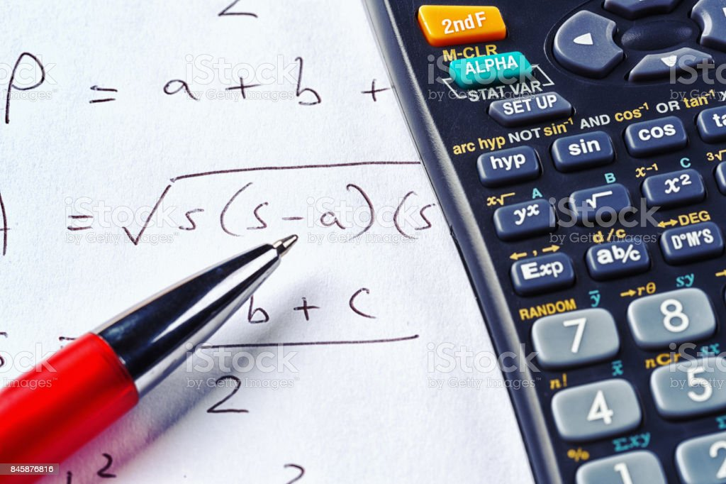 Mathematical equation with ballpoint pen and calculator stock photo