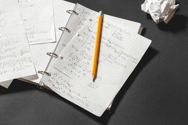 Mathematical equations written in a notebook. stock photo