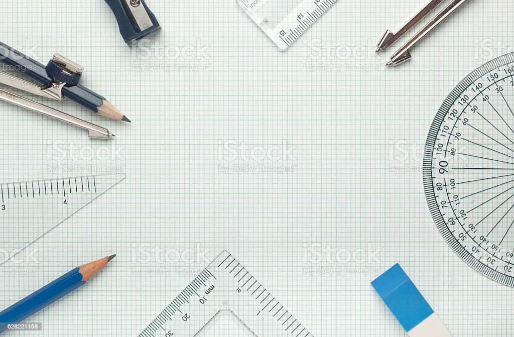 Mathematical instruments on graph paper stock photo