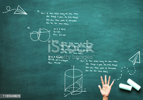 515913038 istock photo mathematical tasks performed on a board and hand 1132045623
