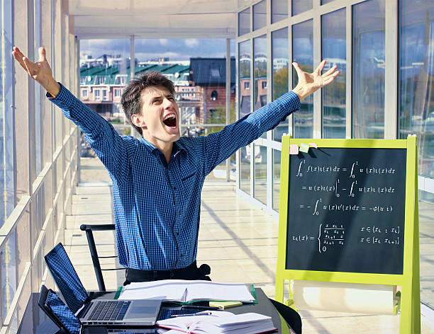 Mathematician scream at workplace. Situation in the office. stock photo