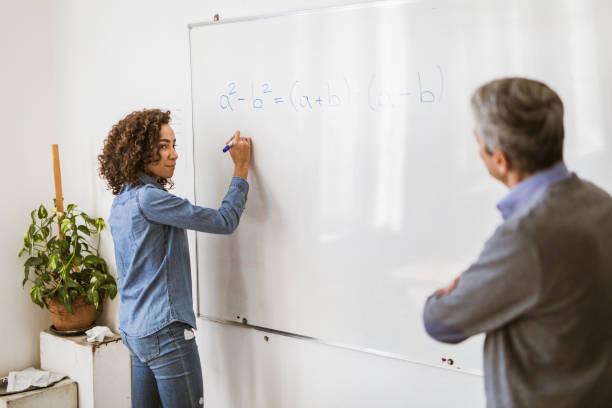 mathematics class at high school! - professore di scuola superiore foto e immagini stock