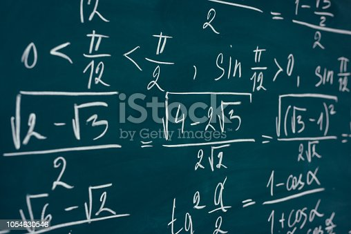 istock Mathematics formulas written on the blackboard. School, education. 1054630546