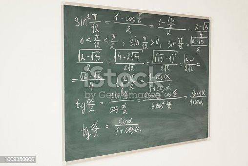 istock Mathematics formulas written on the chalkboard. School, lesson, education. 1009350606