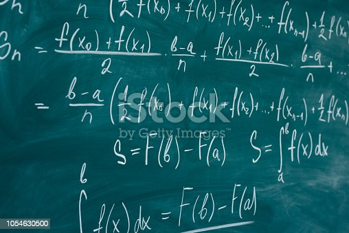 istock Mathematics lesson differential and integral calculus Chalkboard. 1054630500