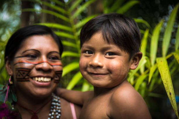 Mather and son from Tupi Guarani tribe in Manaus, Brazil stock photo