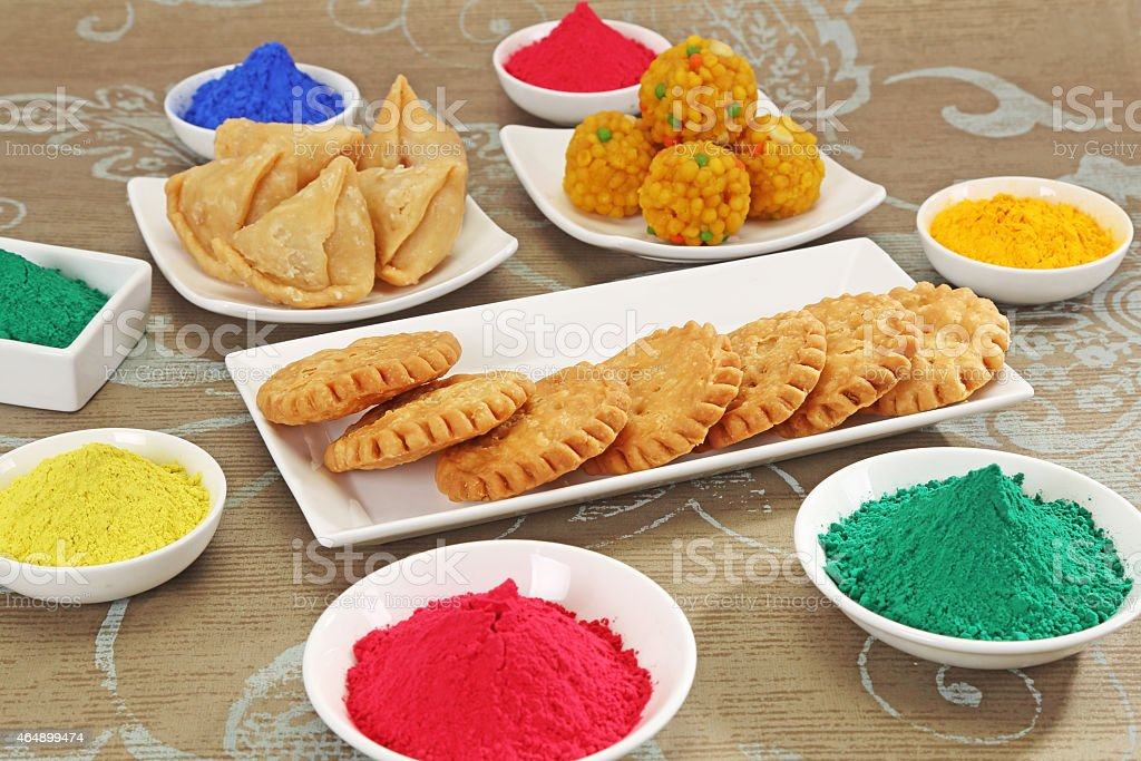 Mathi and Gujiya with Gulal or Face Powder at Holi stock photo