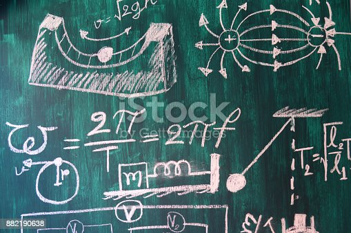 491375966 istock photo Maths and physic formulas written by white chalk on the blackboard background. 882190638