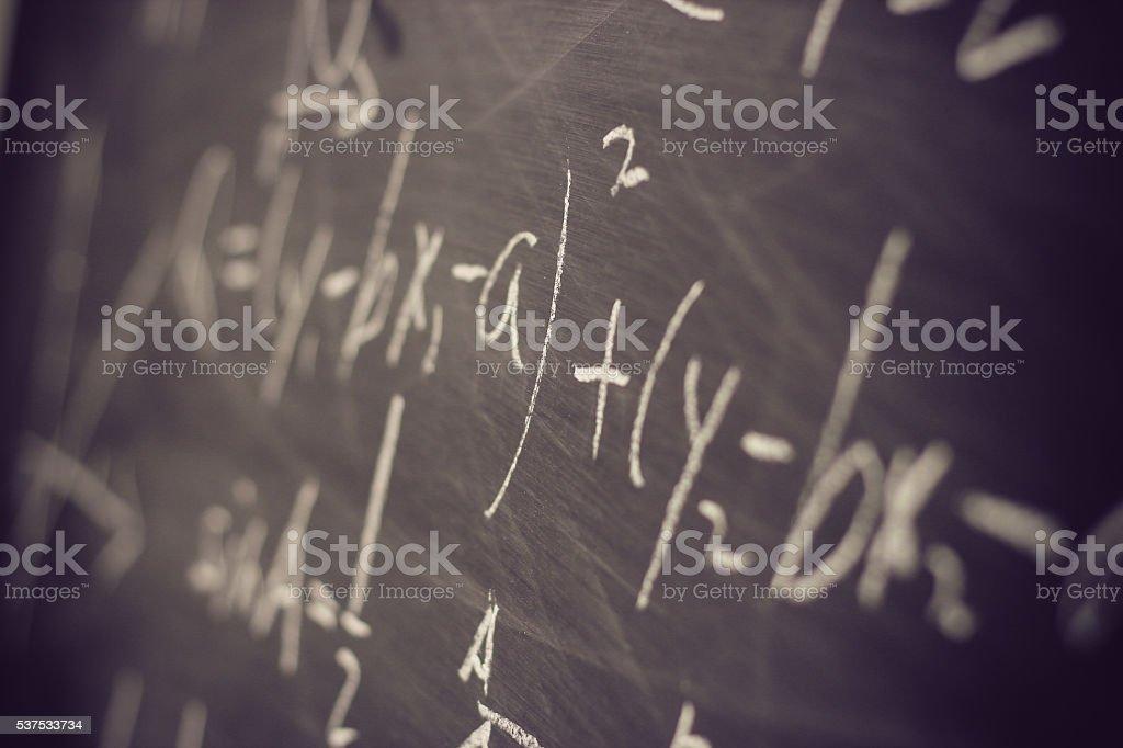 Maths formulas on chalkboard background stock photo