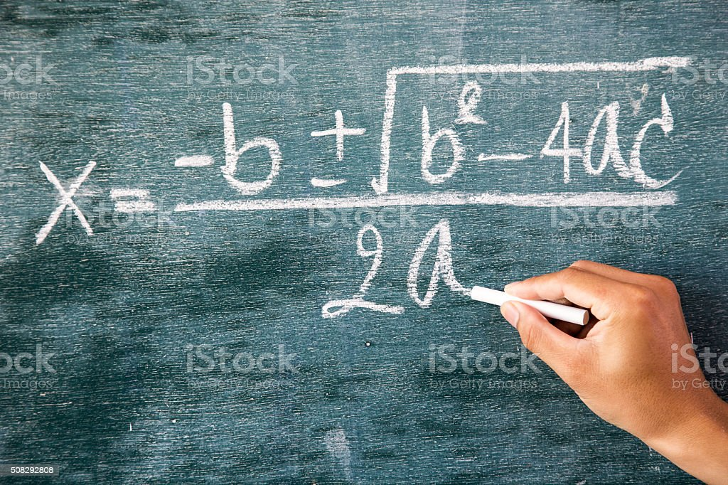 Maths formulas written by white chalk on background,greenboard stock photo