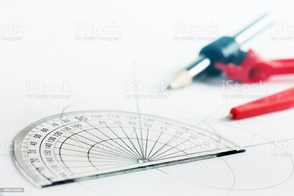 Maths instruments protractor and drawing compass on white stock maths instruments protractor and drawing compass on white royalty free stock photo ccuart Image collections