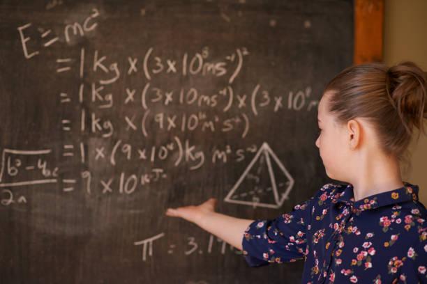 Maths is no match for her brilliant mind - foto de acervo