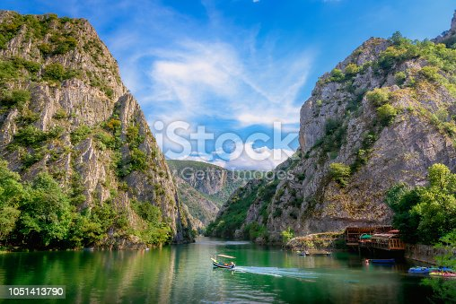Matka canyon in Macedonia near Skopje, boat on the lake. Visit the beautiful places in the world, experience and learn what travel teaches.