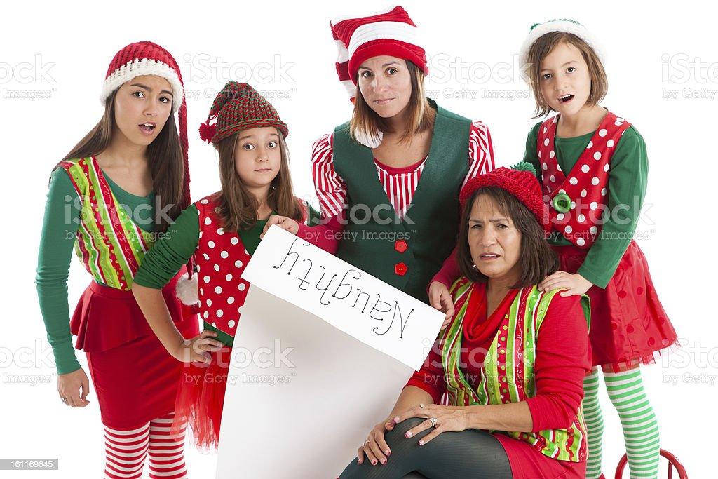 Matriarchal Family Of Hispanic Christmas Elves Reads Santa Clau