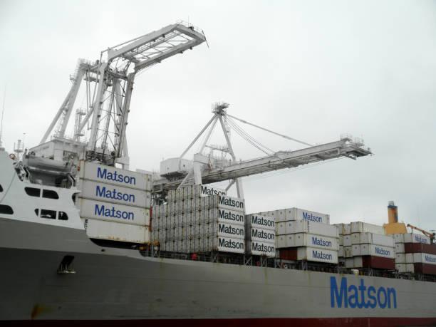 Matson Cargo Ship Mahi Mahi loaded with goods at Port by cranes in Oakland Harbo stock photo
