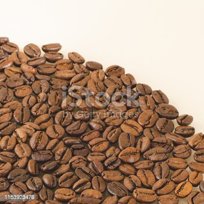 Coffee beans closeup on a white background. Matte shot with empty space on top