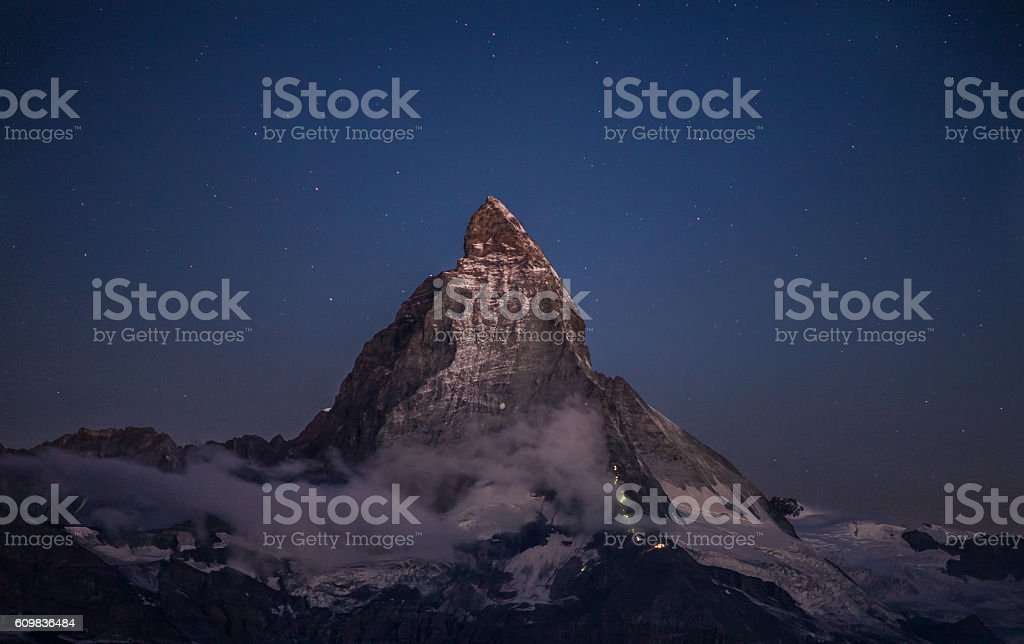 Matterhorn and the climbers at night stock photo