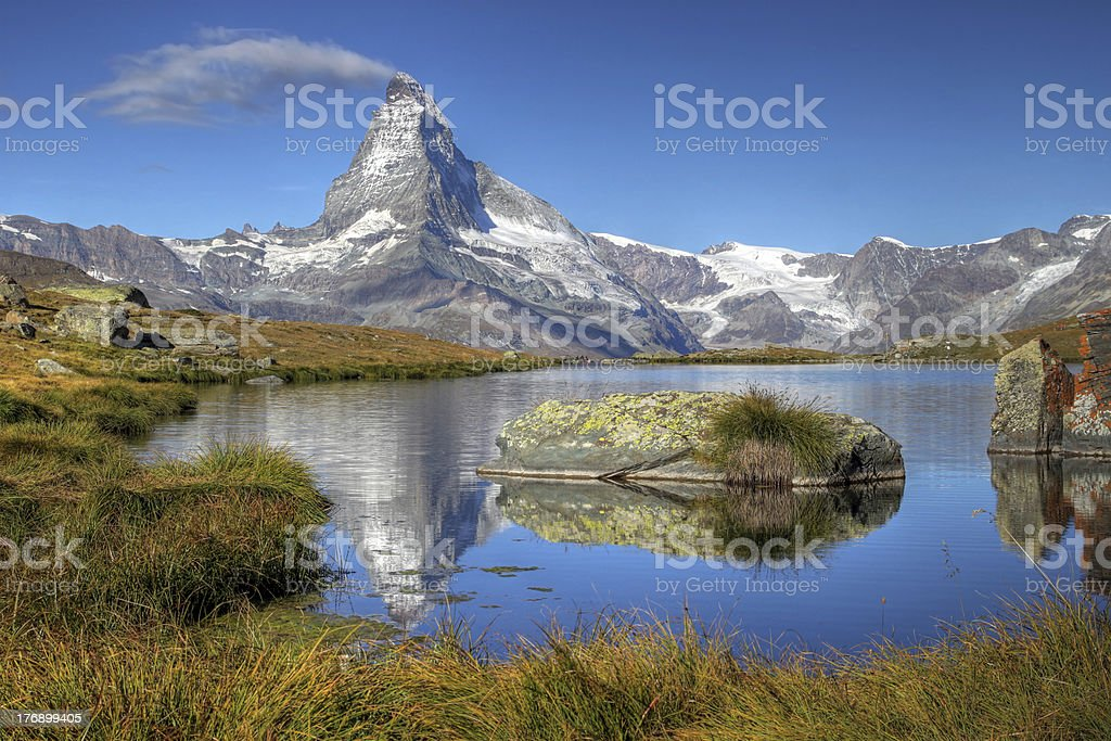 "Matterhorn from Lake Stelliesee 07, Switzerland ""Perfect morning view of Matterhorn (4478m altitude) from Lake Stellisee (2537m altitude), above Zermatt, Switzerland. HDR image to obtain perfectly exposed colors.More images from the"" Europe Stock Photo"