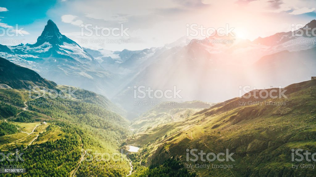 Matterhorn Mountain with white snow and blue sky in Zermatt city in Switzerland stock photo