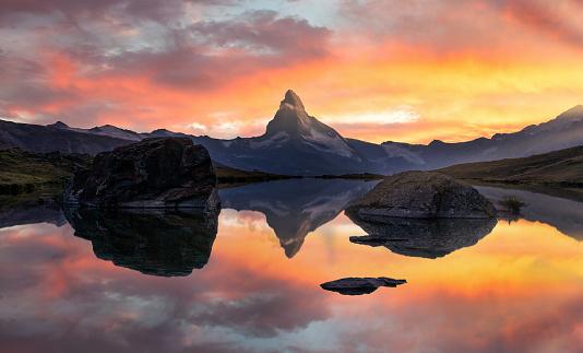 Matterhorn or Cervino reflection on lake stellisee in Zermatt in the mountains in the swiss Alps, Switzerland.