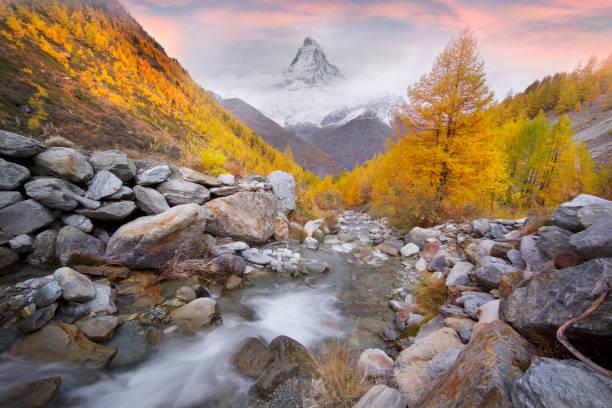 Matterhorn over a mountain stream in autumn stock photo