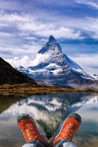 Matterhorn peak with hiking boots in Swiss Alps. stock photo