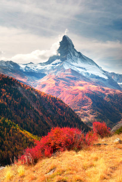 Matterhorn slopes in autumn The fall slopes of the resort of Zarmatt are a local landmark and a bright beautiful landscape with the famous Matterhorn peak in autumn in Switzerland. zermatt stock pictures, royalty-free photos & images