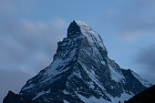 Matterhorn summit beautiful view long exposure shot at dusk taken from Zermatt in Swiss Alps Switzerland