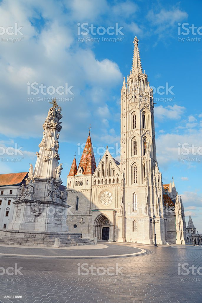 Matthias church and Statue of Holy Trinity in Budapest, Hungary royalty-free stock photo
