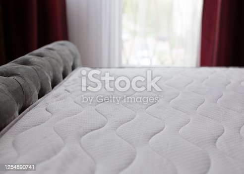 New mattresses on the bed in a domestic bedroom