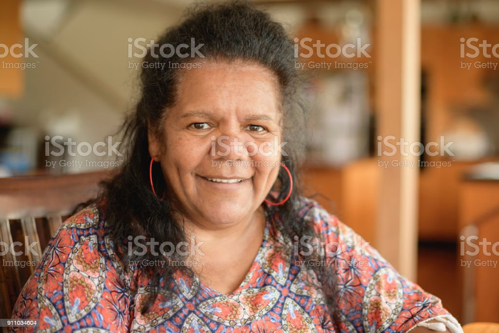 Mature Aboriginal woman looking at camera and smiling stock photo