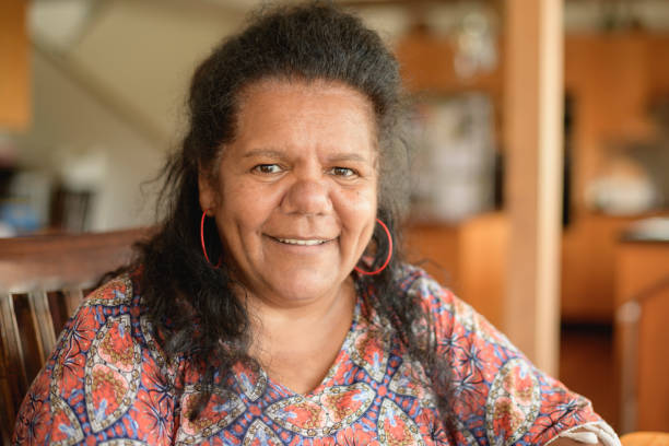 Mature Aboriginal woman looking at camera and smiling stock photo