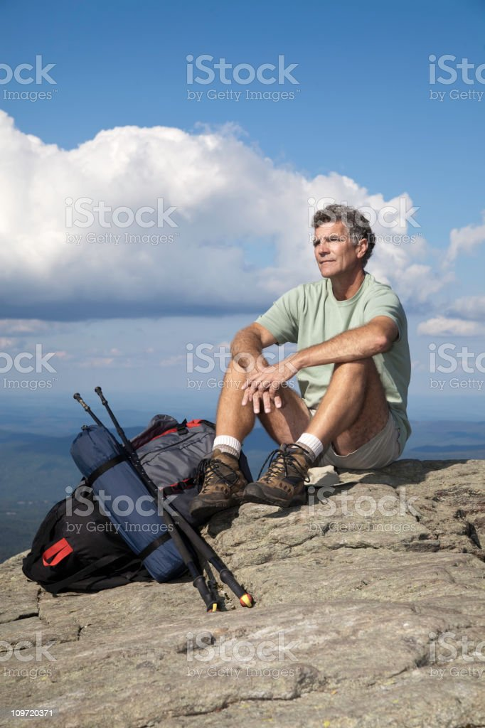 Mature Adult Backpacker on Peak royalty-free stock photo