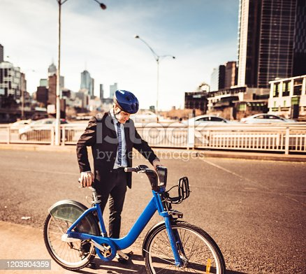 mature adult businessman with bike in melbourne