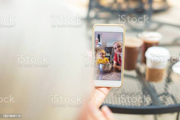 Mature Adult Female On Video Call With Millennial Daughter And Toddler Grandson Mothers Day Photo Series Stock Photo - Download Image Now