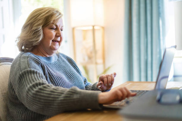 Mature Adult Female Working From Home Office Using Laptop Technology Photo Series In Western Colorado Mature Adult Female Working From Home Office Using Laptop Technology Photo Series Matching 4K Video Available (Shot with Canon 5DS 50.6mp photos professionally retouched - Lightroom / Photoshop - original size 5792 x 8688 downsampled as needed for clarity and select focus used for dramatic effect) eyecrave stock pictures, royalty-free photos & images