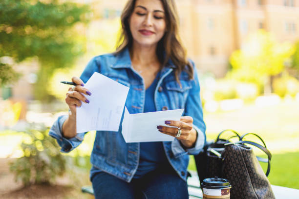 Mature Adult Hispanic Female Voter with Mail-in Voting Election Ballot in Western USA Photo series stock photo