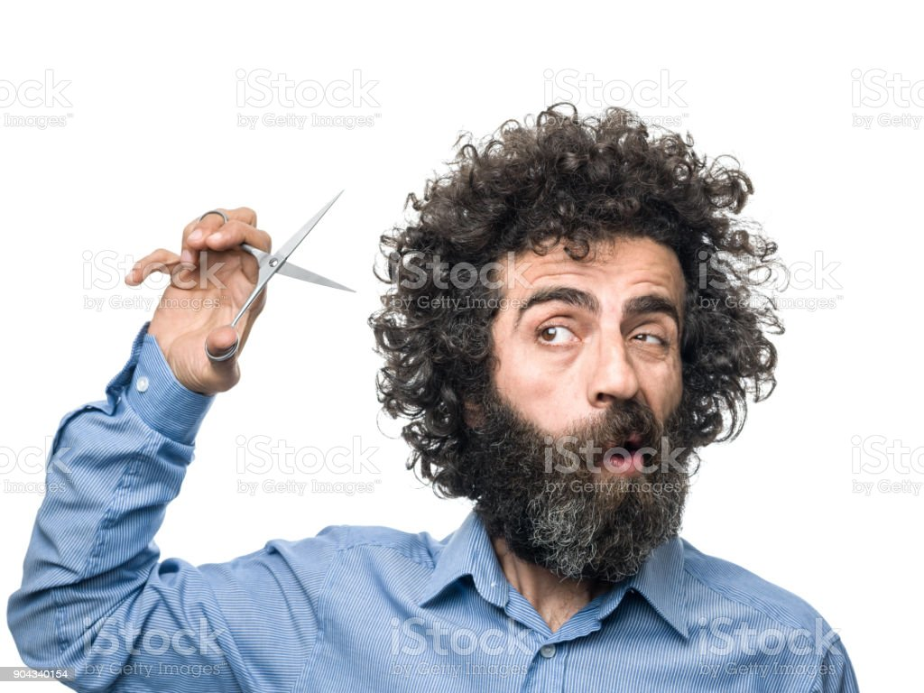 Mature Adult Male Shears Himself With Scissors stock photo