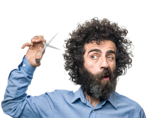 mature adult male shears himself with scissors - messy hair stock photos and pictures