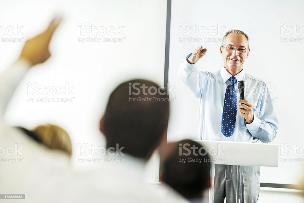 Mature adult man having a public speech. royalty-free stock photo
