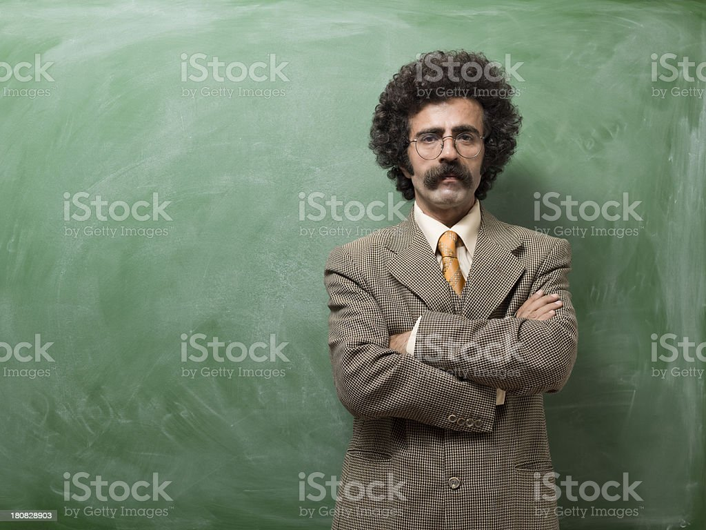 Mature adult man portrait in front of blackboard stock photo