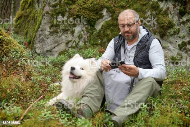 Mature adult man with a white dog outdoors picture id862646880?b=1&k=6&m=862646880&s=612x612&h=wlbybgg4bqnvqlhuxtl c1uehsiowfvh8ze0twlx1ka=