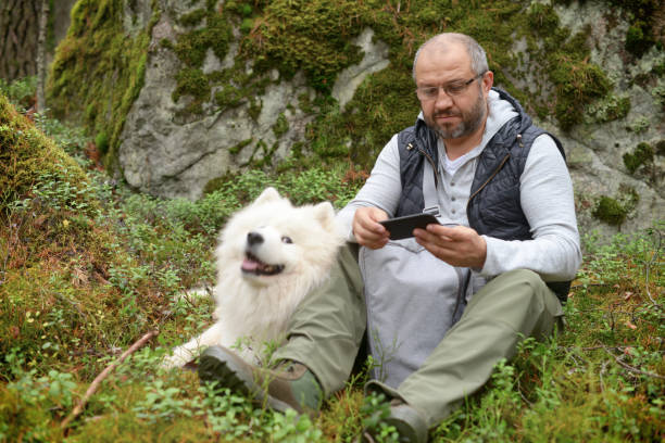 Mature adult man with a white dog outdoors picture id862646880?b=1&k=6&m=862646880&s=612x612&w=0&h=l8fmslmgay7mtrmywdje5ctwpo8jwuu5eouojantht8=
